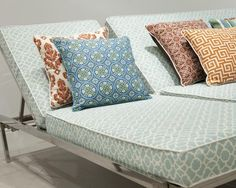 Ice Blue colored Sunbrella cushions with a graphic lattice design adds color to any outdoor oasis.