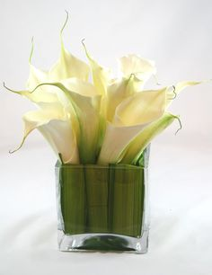 Another cool low arrangement. Calla Lilies accented with striped green bamboo leaves.
