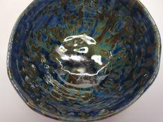 Blue flowing glaze on coil built bowl