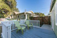Grey deck with white railing, and green chairs.  #RealEstate #Duplex #HouseFlipping #Sunland #California  www.verono.com/nassau