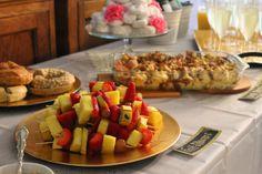 Bridal Shower Brunch food table - fruit skewers, cinnamon bread casserole, donut tower instead of cake