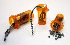 Use old prescription bottles for storage/organization
