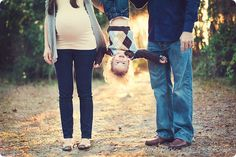 upside down toddler with Mum and dad and bump, fun