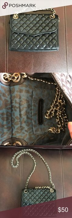 Rebecca Minkoff handbag ❗️ Final Price‼️ 100% Authentic. Retails $195. Bag is in great condition the only problem is the strap where it stretched out but u can tie it & hide it or wear it as a shoulder bag! Color is Black Rebecca Minkoff Bags