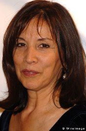 Olivia Harrison.  Strong women who fought off a robber, raised a great son,  had a great love with a great man and is always graceful.