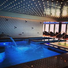 kick back and relax at the Hydrotheraphy pool at the Mandara Spa aboard the Norwegian Breakaway.