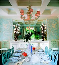 love the color of ther chairs, the light fixture, the wallpaper. ceiling painted blue. love it