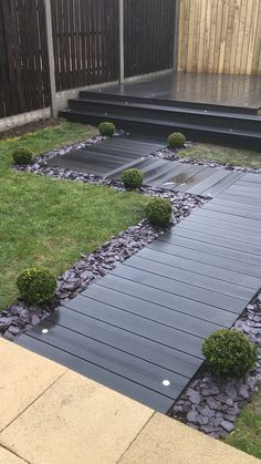 Graphite decking with lights and a slate border. - Graphite decking with lights and a slate border. Landscape Edging Stone, Landscape Design, Backyard Patio Designs, Backyard Landscaping, Patio Ideas, Backyard Ideas, Pebble Landscaping, Modern Backyard Design, Back Gardens