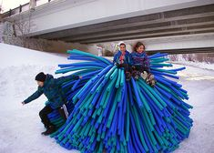 Shelters resembling giant pompoms warm skaters on a frozen river