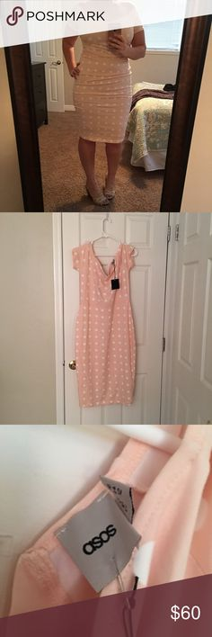 """ASOS Pink Polka Dot Body Con Dress NWT! I can't believe I'm going to sell this one. I have never worn it so it only makes sense. I feel good in this dress. I hate parting with it because part of me is convinced that I'll have a reason to wear it - so only reasonable offers will be accepted. Even though it's shown to be off shoulder - the """"sleeves"""" can be worn on the shoulder as well. ASOS Dresses"""