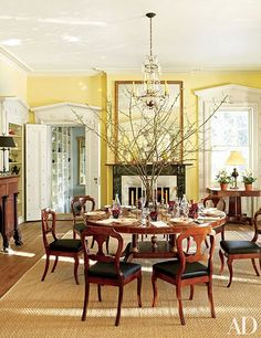 In this Livingston, New York, home, the dining room's Regency-style pedestal table from Stair Galleries is surrounded by circa-1840 side chairs by Duncan Phyfe and Sons; the sisal is by ABC Carpet & Home.