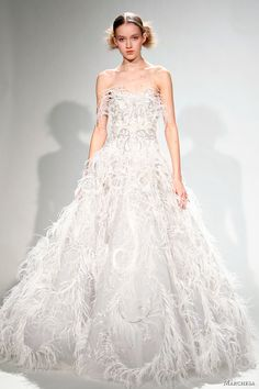Marchesa Strapless white gown with feathers. Marchesa wedding dress