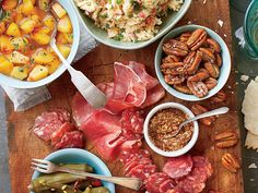 Easy Summer Appetizer Board | Start your party the casual, crowd-friendly way, and let guests help themselves to a variety of bites. No Southern appetizer board is complete without spicy-sweet pickled okra. Our obsession: Wickles Wicked Okra. We also recommend Olli Salumeria salami, slow-cured in Virginia and found in gourmet grocery stores across the South, but you can choose any of your favorite cured meats.