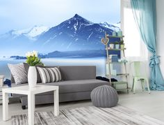 Don't be afraid to use colour and accessories in your bachelor pad! Mountain scape wall mural from Wallsauce.