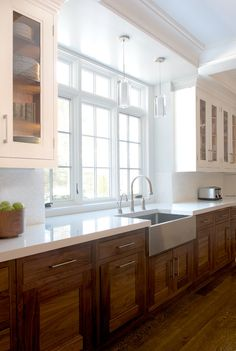 love the white upper/wood lower, sink and white counter tops, hardware