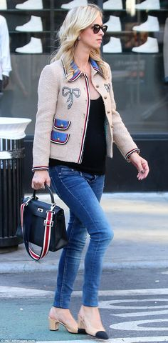 Dressed to impress: Nicky wore a lovely cream jacket embellished with one silver bow on ei...