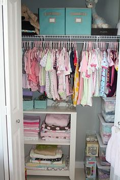 This is probably the closest, most workable idea I've found for M's closet so far. We have a wooden shelf and bar, and I have a ton of plastic bins with her old clothes, similar to the ones on the right in this photo. I like the idea of a shelf on the floor, too.