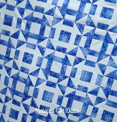 Very effective 2 color quilt -  the placement of the blue and white fabric on each alternating block. Churn Dash {a finished quilt} two color blue and white quilt