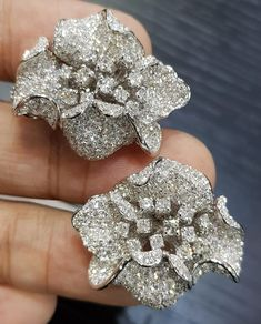 These romantic earrings poetically evoke a tender promise of love. A stylish flower inspired design delicately unfurls its entirely diamond-paved petals, creating the illusion of a real flower with a twinkle of white diamonds by . Real Diamond Earrings, Diamond Jewellery, Vintage Jewellery, Ring Earrings, Dimonds, Earrings Online, Vine Design, White Diamonds, Real Flowers