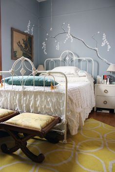 how i can't resist a lovely iron bed. oh, and i like the wall color/painting too.