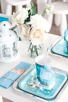 Don't miss this sweet winter wonderland birthday party! The table settings are wonderful! See more party ideas and share yours at CatchMyParty.com #catchmyparty #partyideas #winter #winterparty #penguin #penguinparty #winterwonderland #tablesettings