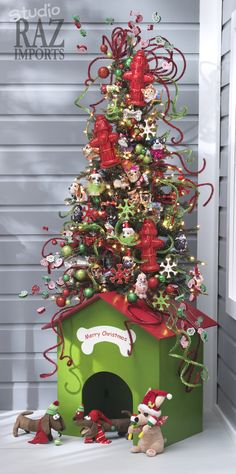 What a jolly little tree. Is it a novelty tree stand or a luxury Christmas doggie house???- just needs a chimney!