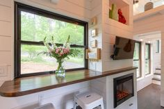 Open plan living space with dining nook and fireplace in Erin Adams' tiny house on wheels Tiny House Swoon, Tiny House Living, Tiny House Design, Tiny House On Wheels, Small House Plans, Small Living, Living Room, Tiny House Trailer, Small House Decorating