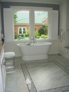 New Era Master Bath for Victorian Style Home, Carrera marble, porcelain tile, Vermont White granite, a pedestal tub and exposed shower fauce...