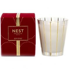 Nest Holiday Candle is the aroma of a sparkling holiday season, created by blending pomegranate, Mandarin orange, pine, cloves and cinnamon with a hint of vanilla and amber. Poured into a striped gold, clear and frosted vessel and boxed in festive holiday packaging. Reminiscent of Slatkin's famous Holiday candle.