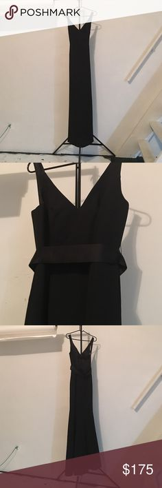 "Stunning Classic Vera Wang Bridesmaid Dress Classic black bridesmaid dress. Sexy open upper-back with strap and satin belt. It runs slightly big for a size 2 if you have A-B cup tata's and long for anyone that is 5'4"" or shorter. It's in its original condition with no custom alterations. If purchasing for a wedding I would suggest taking it in at the bust if you have a smaller cup size and trimming length. Take alts into consideration when purchasing. Alts could take between one week to one…"