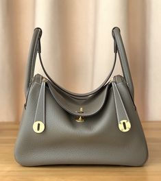 Hermes Lindy 30 Gris Perle Eclat Crevette Taurillon Clemence Palladium HW Color:Gris Perle (Pearl HardwareAccessories:Box,Cotton bagCondition: Pristine Retail Price June sale with complete package and purchase receipt. Hermes Lindy Bag, Hermes Bags, Hermes Handbags, Burberry Handbags, Luxury Handbags, Purses And Handbags, Hermes Birkin, Fall Handbags, Guess Handbags