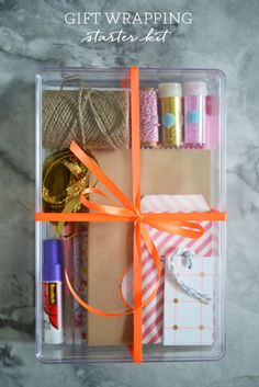 Looking for a thoughtful gift? Cupcakes and Cashmere shows you how to put together a gift wrapping starter kit that features Souffle pens and Quickie Glue.