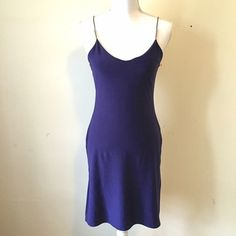 Vintage Jeffrey Rogers Slinky Purple Dress Sexy purple spaghetti strap dress from British designer Jeffrey Rogers. Silver tube bead detailing on straps, side slits. Tag reads size 10 (British sizing) so is a US 6. Excellent condition! Jeffrey Rogers Dresses Mini