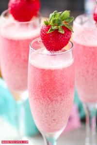 Strawberry Cream Mimosa on MyRecipeMagic.comBubbly champagne with frozen strawberry and raspberry cream ice cubes.