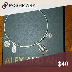 Alex and ani Star Wars bangle Silver Alex and ani bangle bracelet with  R2 D2 charm  Rarely found item, it was purchased about a month ago so it is in perfect condition still! Alex & Ani Jewelry Bracelets