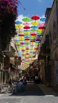 girlactionfigure:  Jerusalem of Colorful UmbrellasThe City of Jerusalem decorated Nachalat Shiva in this interesting and colorful way…Life in Israel