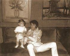 Vintage photo of Elvis Presley and baby Lisa Marie.