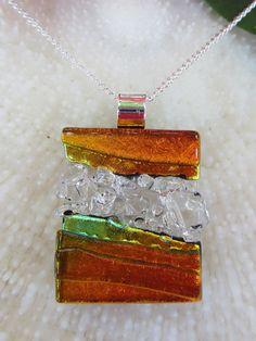 Transparent and dichroic orange fused glass texture pendant