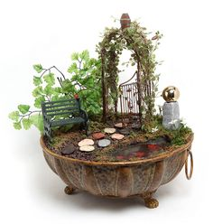 Great idea for an old planter--a fairy garden