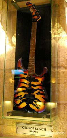 """George Lynch Of Dokken/Lynch Mob/George Lynch's Soul's Of We/KMX/T&N; His ESP """"Sunburst Tiger Stripe"""" Guitar, On Display At The Hard Rock Cafe, In California!... ;)"""