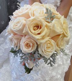 Cream and blush roses and silver grey foliage.