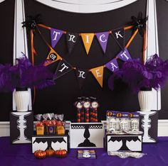 Love this idea of printing cake stand silhouettes on boxes to give the table different heights without needing that many stands.
