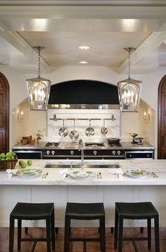 like the lights!!! Tradional kitchen with a Modern approach.