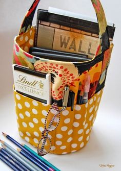 I love this idea for keeping things handy.  Most likely I'll keep it in the car.