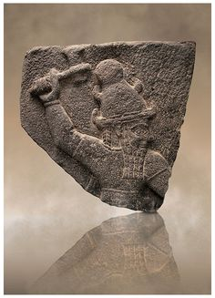 Neo Hittite Basalt relief sculpture for Carchemish of a Syrian storm god who traditionally wears a horned headdress. 10th century B.C form Carchemish , south-east Anatolia -  Turkey.  | © Paul E Williams