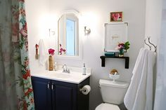 Ideas for guest bath -- shelf over toilet, hooks on wall, pink