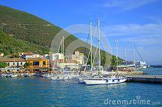 Anchored boats and colorful houses  of Vasiliki harbour ,Lefkada  island, Greece