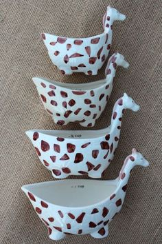 Measuring cups that look like playful giraffes add a bit of whimsey to the kitchen.