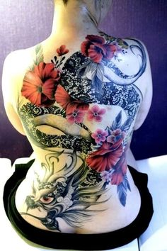 Awesome feminine dragon back peice! Very unique and beautiful with the lace effects