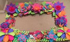 Trolls theme party photo backdrop done with paper flowers